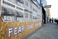 """A sign that reads """"Fear causes racism"""" is seen on a boarded-up shopfront in Seattle, Washington, in March. Photo: Reuters"""