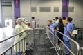 Staff working in different areas at the expo testing facility were separated by barriers. Photo: Handout