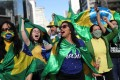 Supporters of far-right Brazilian President Jair Bolsonaro take part in a protest against social distancing and quarantine measures on Sunday. Photo: Reuters