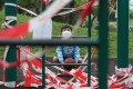 A boy amuses himself in a cordoned off playground in Kowloon City on April 25. With public indoor and outdoor play areas closed as a Covid-19 prevention measure, Hong Kong children have found themselves increasingly cooped up at home. Photo: Xiaomei Chen