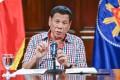 President Rodrigo Duterte has ordered the insurance premiums to be made voluntary rather than mandatory. Photo: AP