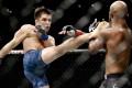 Henry Cejudo kicks Demetrious Johnson during their flyweight title bout at UFC 227. Photo: AP
