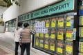 Bills stuck on a property agent's office on March 4, 2020, says buyers should take advantage of the Federal Reserve's rate cut as it will boost Hong Kong's housing market. Photo: Handout