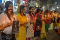 Indian protesters hold candles and placards during a candle light procession calling for justice following the rape and murder case of a 27-year-old veterinary surgeon in Hyderabad in November 2019. Photo: AFP