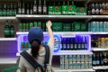A woman buys beer in a Bangkok supermarket after the government lifted a ban on alcohol sales that had been in place since April 10. Photo: Reuters