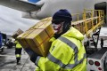Ground crew members at the Los Angeles International Airport unload supplies of personal protective equipment. Photo: AP