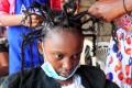 Martha Apisa, 12, gets the coronavirus hairstyle at Mama Brayo Beauty Salon in Kibera, in Nairobi, Kenya. Photo: Reuters