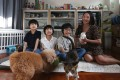Agnes Ng with her children, pets and fostered rabbit at her home in Stanley, Hong Kong. Pet fostering has become common around the world, and in Hong Kong now there are more would-be fosterers than there are pets needing fostering. Photo: Jonathan Wong
