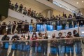 Demonstrations in malls have seen retailers close early, something Financial Secretary Paul Chan said is tantamount to 'taking away their only room to survive'. Photographer: Bloomberg