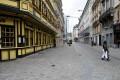 Pedestrians walk past closed shops in Brussels. Photo: Reuters