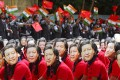 Students in Chennai, India, wear masks of China's President Xi Jinping as others wave the national flags of India and China, ahead of his informal summit with Indian Prime Minister Narendra Modi, on October 10 last year. Photo: Reuters
