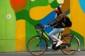 A cyclist wears a protective mask in Brussels, Belgium. Photo: Reuters