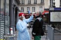 A health worker collects a nasal swab sample from a man to test for the coronavirus in Paris, as France cautiously eases its two-month lockdown. Photo: AP