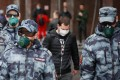 Guards in protective masks patrol near the Red Square in Moscow. Photo: EPA-EFE