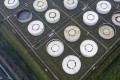 Oil storage tanks are seen in this aerial photograph taken on the outskirts of Ningbo, Zhejiang province, China on April 22. Oil glut has left the industry short of storage capacity, abetting the slump in crude prices. Photo: Bloomberg