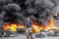 Tires burn amid protests against the killing of at least one civilian during enforcement action for an overnight curfew intended to curb the spread of the new coronavirus, in Mogadishu, Somalia, on April 25. Photo: AP