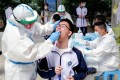 China is making it much easier for people to get tested for Covid-19. Photo: Reuters