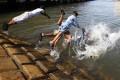 Children swim to beat the heat during the Muslim holy month of Ramadan in Sindh province, Pakistan. Photo: EPA