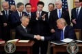 Chinese Vice-Premier Liu He and US President Donald Trump signed the phase one trade deal in January. Photo: Reuters