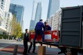 A truck is unloaded in Beijing's central business district. The logistics property sector has benefited from the outbreak and the resulting containment measures. Photo: Reuters