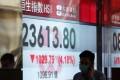 A person walks past a stock quotation board showing the Hang Seng Index in Hong Kong on May 4, 2020. Photo: Xinhua