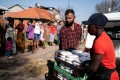 Members of a local charity deliver food in the Johannesburg suburb of Vrededorp on Tuesday, as South Africa and many other African countries start feeling the impact of the coronavirus pandemic. Photo: AFP
