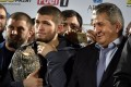 UFC lightweight champion Khabib Nurmagomedov with his father Abdulmanap during a ceremony upon their return to Russia after his win against Conor McGregor. Photo: AFP