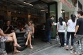 Customers queue for a seat at a restaurant in Central, Hong Kong, where precautions taken to combat Covid-19 have been a success. The company behind World's 50 Best Restaurants is fundraising to keep restaurants in business. Photo: Xiaomei Chen
