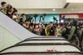 Members of the press record the scenes from an escalator during a protest at New Town Plaza in Sha Tin on May 1. Photo: Felix Wong