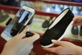 Online customers are shown a shoe in a live-stream from the Neiliansheng footwear store in Beijing. Retailers in China are embracing live-streaming as a sales channel as people continue to be wary of physical stores. Photo: AP