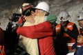Then Chilean president Sebastian Pinera (right) hugs a miner rescued from the collapsed San Jose gold and copper mine where he was trapped with 32 others for over two months, near Copiapo, Chile, on October 12, 2010. Pinera won a second term in December 2017. Photo: AP/Chilean presidential press office