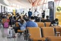 Passengers at a boarding area for domestic flights at the Beijing Capital International Airport on May 10, 2020. Photo: Kyodo
