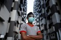 A migrant worker is seen at a dormitory in Singapore, amid an outbreak of coronavirus cases among foreign workers. Photo: Reuters