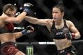 UFC women's strawweight champion Zhang Weili punches Joanna Jedrzejczyk at UFC 248. Photo: AP