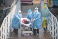 Medical workers take a coronavirus patient to hospital in Wuhan, the outbreak's initial epicentre. Photo: Xinhua