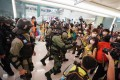 Police approach reporters covering an anti-government protest at New Town Plaza in Sha Tin on May 1. Photo: Felix Wong