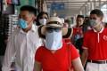 Vietnamese tourists visit Ha Long Bay. Photo: Reuters