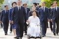 South Korean President Moon Jae-in holds the hand of Lee Yong-soo during a trip to a comfort women's cemetery in Cheonan, South Chungcheong Province, South Korea. Photo: EPA