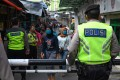 Indonesian police conduct an operation against market vendors defying a partial lockdown as part of efforts to stop the spread of Covid-19. Officials are on alert as the end of Ramadan approaches. Photo: AFP