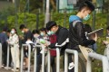 Student revise as they wait to be seated for a Diploma of Secondary Education exam, at a school in Tsuen Wan on April 27. Photo: Felix Wong