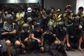 Journalists wear safety equipment at a Hong Kong police press conference at the force's headquarters in Wan Chai on September 9, 2019. The safety gear was in protest against what they described as brutality by officers towards media workers on duty at protest sites. Photo: EPA-EFE