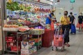 Customers shop at a market in Singapore on May 20, 2020. Photo: Bloomberg