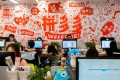 People are seen at their desks at the headquarters of Chinese e-commerce firm Pinduoduo in Shanghai, China July 25, 2018. Photo: Reuters