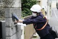 A mail carrier delivers cloth masks in Tokyo in April, during a coronavirus outbreak in Japan. Photo: Kyodo
