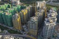 K Wah International's Solaria project, in the yellow cladding in the middle, in Hong Kong's Tai Po district. Photo: Martin Chan