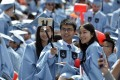 Chinese Graduates of Columbia University attend the commencement ceremony in New York City. Photo: Xinhua