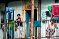 Migrant workers gather at a balcony at their living quarters in Male. Photo: AFP