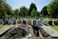 A worker prepares a grave for burial at Woodlawn Cemetery in Everett, Massachusetts, on Wednesday. Photo: Reuters