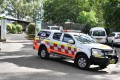 A New South Wales ambulance vehicle is seen at the Shoalhaven Zoo in Nowra, south of Sydney, after a staff member was critically injured in a lion attack. She was airlifted to a Sydney hospital. Photo: EPA-EFE
