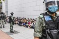 Riot police detain a group of people in Causeway Bay, Hong Kong on May 27, 2020. Photo: EPA-EFE